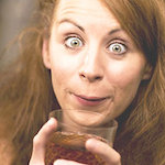Surprised woman holding drink - Do you drink more than you think, by Adrienne Wyper