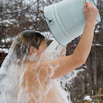 Woman throwing bucket of water over herself - Beat the heat of a hot flush, by Adrienne Wyper